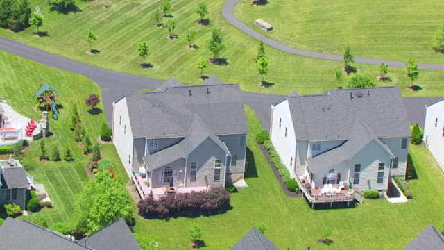WS ZO AERIAL POV Exterior of orbit homes with road and standing water / Virginia, United States