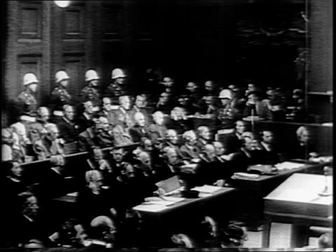 exterior of palace of justice in nuremberg / soldiers standing outside of courthouse / low angle shot of us soldiers standing on tank / guards in... - galgen stock-videos und b-roll-filmmaterial