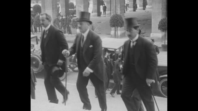 exterior of palais de rumine in lausanne / wearing top hats several unidentified men and a woman arrive in automobiles and climb a long flight of... - seal stamp stock videos and b-roll footage