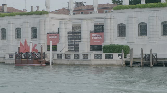 ws exterior of peggy guggenheim collection, passenger craft moving in foreground / venice, italy - passenger craft stock videos & royalty-free footage