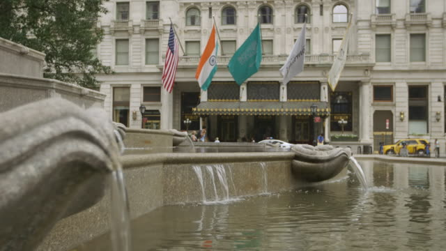 WS R/F Exterior of Plaza Hotel, fountain in foreground / Manhattan, New York City, New York State, United States