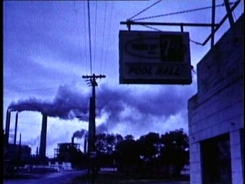 1967 ms exterior of pool hall with smoke stacks in background / panama city beach, florida / audio - pool hall stock videos and b-roll footage