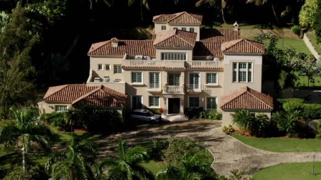 ws aerial pov exterior of ricky martin's mansion / dorado, puerto rico, united states  - ricky martin stock videos and b-roll footage