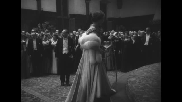 exterior of ridderzaal / the royals, queens ingrid and juliana with king frederick, and prince bernard - the women step up to platform / room crowded... - dressing up stock videos & royalty-free footage