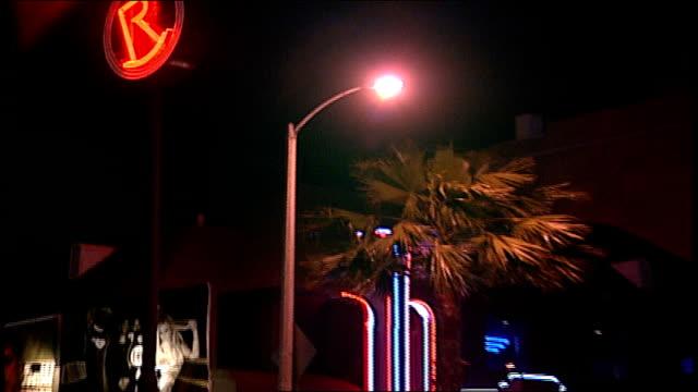 vídeos de stock, filmes e b-roll de exterior of roxy nightclub and sign at night in los angeles california - 2003
