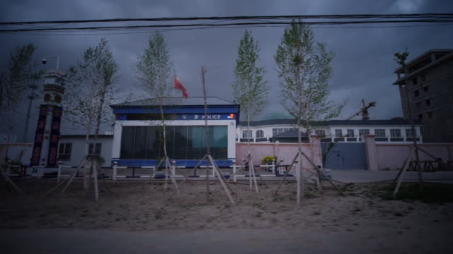 exterior of secure facility in china for muslim ethinc groups showing barbed wire and watch tower - xinjiang province stock videos & royalty-free footage