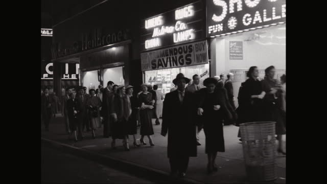 ws pov exterior of shops with crowd walking on sidewalk, cars parked on street / times square, midtown manhattan, new york city, new york state, united states - new york city 1950s stock videos & royalty-free footage