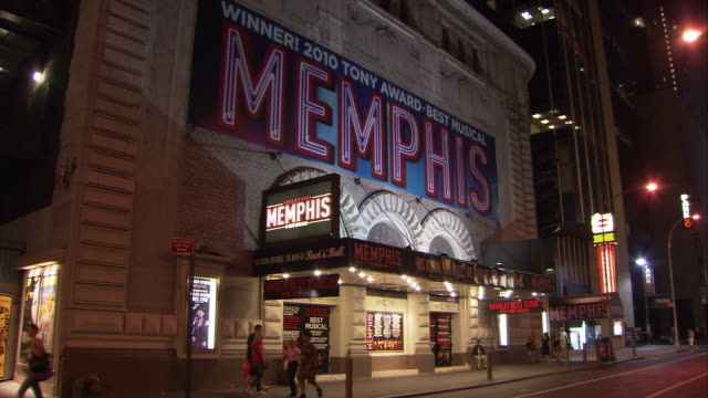 ws exterior of shubert theatre with 'memphis' musical ad illuminated at night, broadway / new york city, new york, usa - broadway manhattan stock-videos und b-roll-filmmaterial