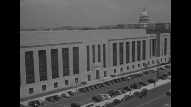 vs exterior of social security building where office of war information is housed / shot of us capitol / note exact day not known - social security stock videos and b-roll footage