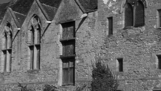 1946 pan exterior of stokesay, a fortified manor house / shropshire, england, united kingdom - stokesay castle stock videos and b-roll footage