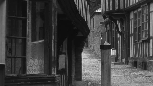 1946 montage exterior of tall city houses on narrow streets / united kingdom - row house stock videos and b-roll footage