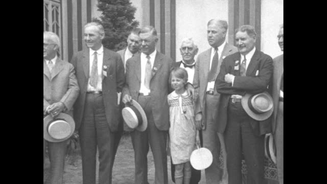 exterior of the art deco building pittsburgh local dignitaries with mayor w freeland kendrick holding a straw boater hat and cane / kendrick daniel... - straw hat stock videos & royalty-free footage