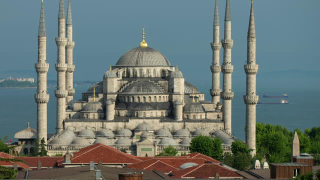 t/l pan zo exterior of the blue mosque against the sea of marmara in istanbul, turkey - blue mosque stock videos and b-roll footage