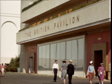 exterior of the british pavilion at ny world's fair / british flags atop building british pavilion at ny world's fair on january 01, 1939 in new... - new york world's fair stock videos & royalty-free footage