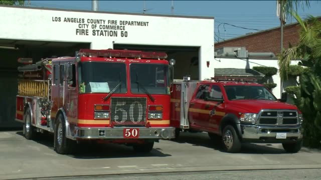 ktla exterior of the commerce fire station fire truck driving off with siren on closeup of fire truck/logo the commerce fire station and neighbors... - fire station stock videos & royalty-free footage
