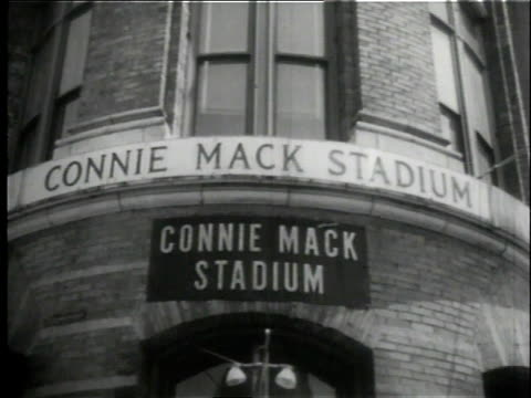 exterior of the connie mack stadium / joe adcock holding bat over his shoulder - atlanta braves stock-videos und b-roll-filmmaterial