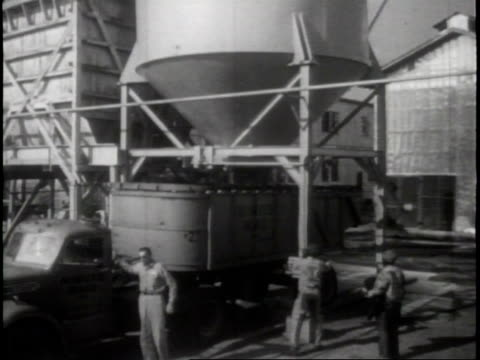 exterior of the minute maid by-product plant / a worker pulls a pick up truck to load it with waste leftover in order to process it into molasses and... - plant process stock videos & royalty-free footage