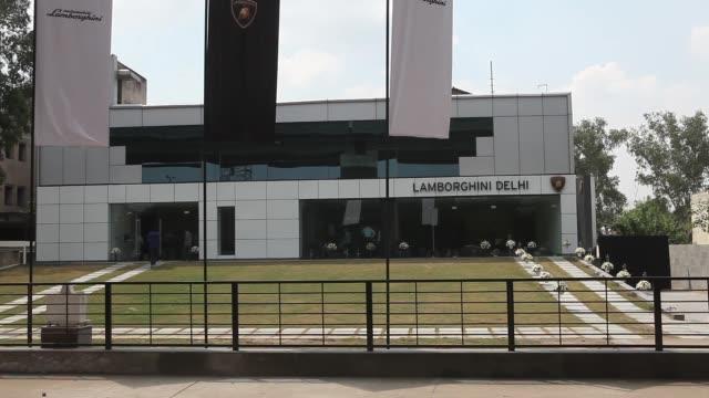 exterior of the new lamborghini spa delhi dealership in new delhi india on monday sept 23 members of the media film a lamborghini gallardo lp 5502... - alloy stock videos & royalty-free footage