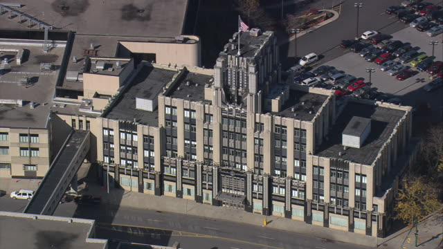 AERIAL Exterior of the Niagara Mohawk Building with parking lot beyond / Syracuse, New York, United States