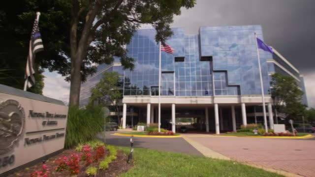 exterior of the nra, national rifle association, headquarters in virginia, usa - 全米ライフル協会点の映像素材/bロール