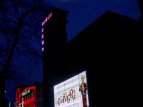 exterior of the odeon cinema on leicester square 1969 - odeon kinos stock-videos und b-roll-filmmaterial