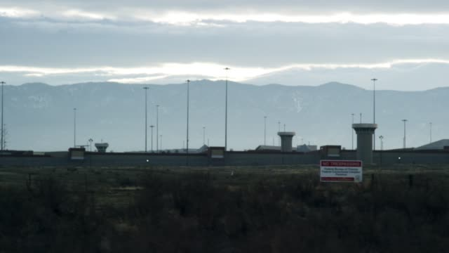 "exterior of the united states penitentiary, administrative maximum facility supermax prison complex in florence, colorado (fremont county) under the rocky mountains - the ""alcatraz of the rockies"" - federal prison building stock videos & royalty-free footage"