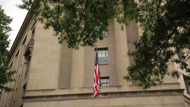 Exterior of The US Department of Justice headquarters stands in Washington DC US on Thursday August 15 2019 The Justice Department is seeking...