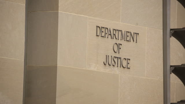 exterior of the us department of justice headquarters stands in washington dc us on thursday august 15 2019 the justice department is seeking... - department of justice stock videos & royalty-free footage