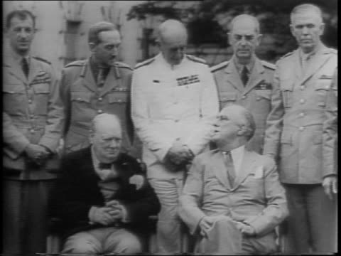 stockvideo's en b-roll-footage met exterior of the white house / prime minister winston churchill and president franklin roosevelt meet to discuss the effects of the african campaign /... - generaal militaire rang