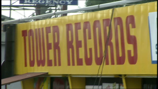 exterior of tower records with sign and full parking lot in los angeles california - tower records stock videos & royalty-free footage