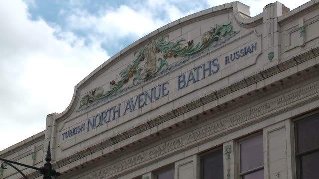 """exterior of turkish north avenue baths facade with signs for new restaurant """"trench"""" in chicago on april 26, 2017. - bathhouse stock videos & royalty-free footage"""