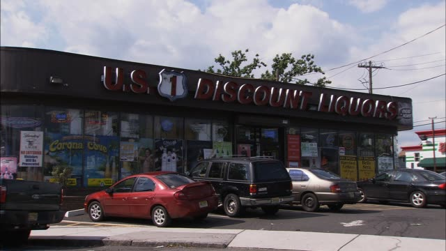 exterior of us discount liquors route 1 / route 9 elizabeth nj / cu on store sign liquor store on august 21 2012 in elizabeth new jersey - liquor store stock videos and b-roll footage