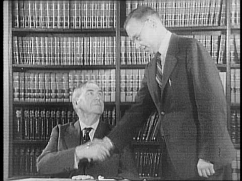 exterior of us supreme court building / close up of harlan fiske stone / harlan stone shaking hands with his son lauson stone / harlan and lauson... - court room stock-videos und b-roll-filmmaterial