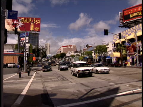 exterior of whiskey a gogo with sunset blvd sign - sunset boulevard stock-videos und b-roll-filmmaterial