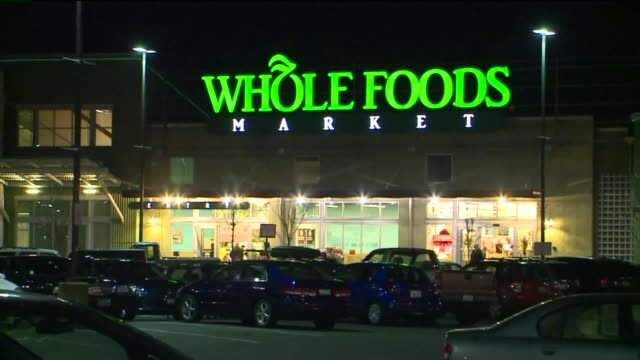 kcpq exterior of whole foods at night in seattle - whole foods market stock videos and b-roll footage