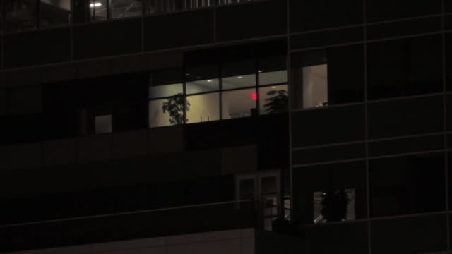 LA Exterior office apartment windows dimly lit at night