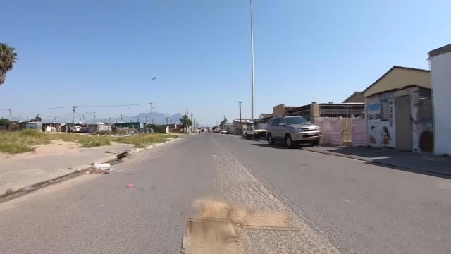exterior point of view driving shots through nyanga township ahead of a visit by prince harry and meghan on 24 september 2019 in cape town, south... - テーブルマウンテン国立公園点の映像素材/bロール