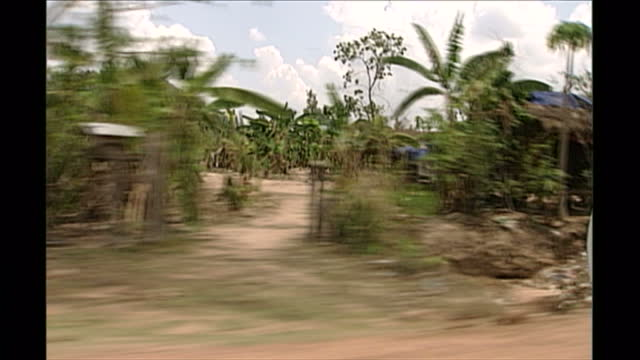 exterior point of view driving shots through the cambodian countryside on april 27th 1998 in phnom penh cambodia - cambodia stock videos & royalty-free footage