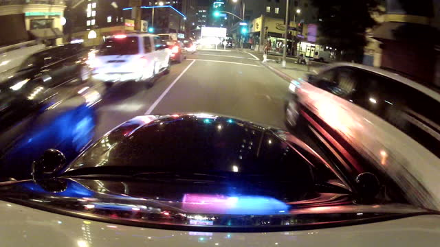 exterior point of view shots driving around in a police car in downtown la with blue lights and sirens sounding during a police chase on january 28... - police car stock videos & royalty-free footage