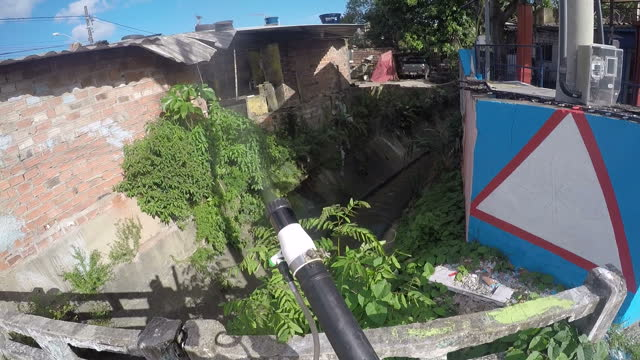 exterior point of view shots of a council worker in recife fumigating against mosquitoes, walking through a residential area spraying houses,... - spraying stock videos & royalty-free footage