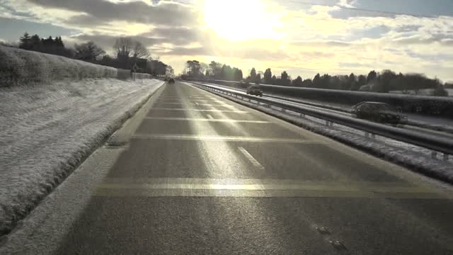 Exterior pov from car driving on snow covered road on 9th December 2017 Broomsgrove England