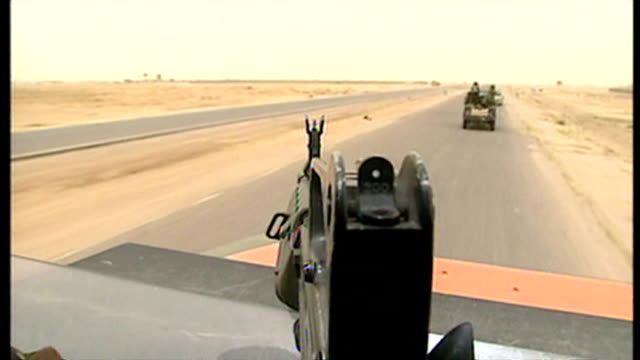 exterior pov shots from top of british military land rover as it travels along road in southern iraq at the start of the 2003 invasion of iraq on... - british military stock videos and b-roll footage