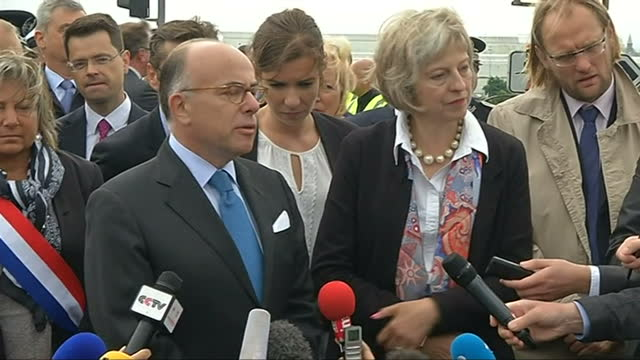 exterior press statement with french interior minister bernard cazeneuve about the migrant crisis in calais on august 20, 2015 in calais, france. - bernard cazeneuve stock videos & royalty-free footage