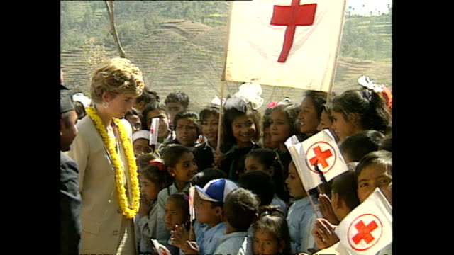 exterior princess diana princess of wales meeting locals holding red cross flags at panauti red cross project during her royal visit on 5 march 1993... - rotes kreuz organisierte gruppe stock-videos und b-roll-filmmaterial