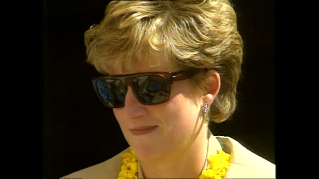 stockvideo's en b-roll-footage met exterior princess diana princess of wales sitting smiling and chatting with officials at panauti red cross project during her royal visit on 5 march... - koninklijk persoon