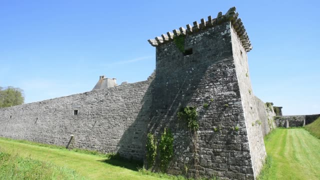 exterior ramparts to chateaux kerjean-brittany - david johnson stock videos & royalty-free footage