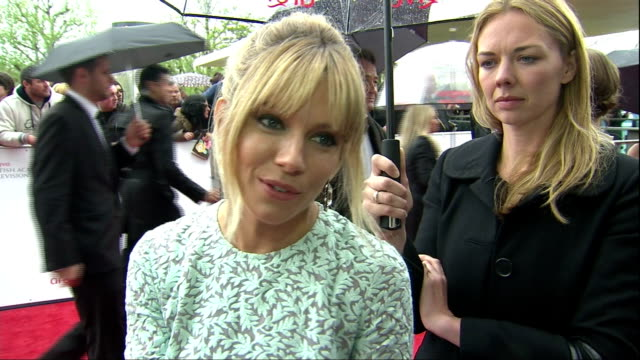 exterior red carpet interview sienna miller, nominated for leading actress & wearing powder blue matthew williamson dress, talks about what she... - royal blue stock videos & royalty-free footage
