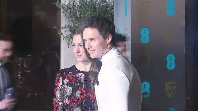 stockvideo's en b-roll-footage met exterior red carpet shots of eddie redmayne actor with wife hannah bagshawe publicist at the bafta awards at the royal albert hall on february 12th... - publiciteitsmedewerker