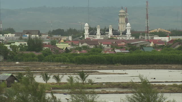 Exterior rooftops of Banda Aceh including the Baiturrahman Grand Mosque on the coast on September 10 2014 in Banda Aceh Indonesia