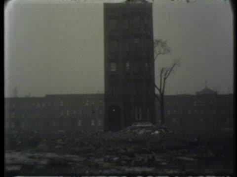Exterior scenes of public housing and derelict buildings in Harlem